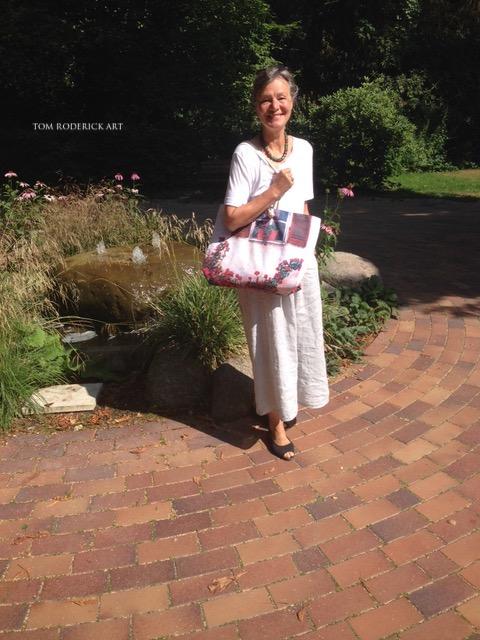 Art lover in Berlin showing off her beautiful weekender bag by Boulder artist Tom Roderick.