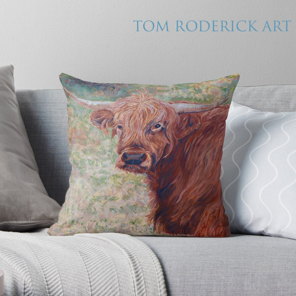 Throw pillow of Wink the Highland Cow by Boulder artist Tom Roderick.