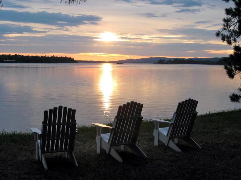 Empty Chairs for loved ones on the Ottawa river at sunset.